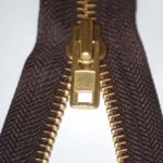Brown brass zip